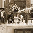 Charles Chaplin, Roscoe 'Fatty' Arbuckle, Al St. John, and Mack Swain in The Knockout (1914)