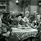 Robert Mitchum, Paul Hurst, Sarah Padden, and Chili Williams in Girl Rush (1944)