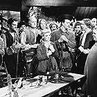 John Wayne, Earl Askam, Robert Barrat, Lew Harvey, Robert McKenzie, Moroni Olsen, Russ Powell, Claire Trevor, and Chill Wills in Allegheny Uprising (1939)