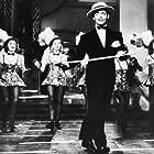 Clark Gable, Virginia Dale, and Paula Stone in Idiot's Delight (1939)