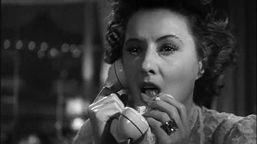 While on the telephone, a physically impaired woman overhears what she thinks is a murder plot and attempts to prevent it.