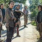 Norman Reedus, Michael Cudlitz, Seth Gilliam, Melissa McBride, Lauren Cohan, Tyler James Williams, Steven Yeun, and Josh McDermitt in The Walking Dead (2010)