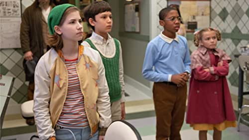 """After winning a scholarship competition, four gifted orphans are recruited by the peculiar Mr. Benedict for a dangerous mission to save the world from a global crisis known as The Emergency. Reynie, Sticky, Kate, and Constance must infiltrate the mysterious L.I.V.E. Institute to discover the truth behind the crisis. When the headmaster, the sophisticated Dr. Curtain appears to be behind this worldwide panic, the kids of """"The Mysterious Benedict Society"""" must devise a plan to defeat him."""