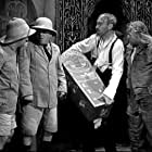 Moe Howard, Larry Fine, and Curly Howard in We Want Our Mummy (1939)