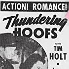 Tim Holt and Luana Walters in Thundering Hoofs (1942)