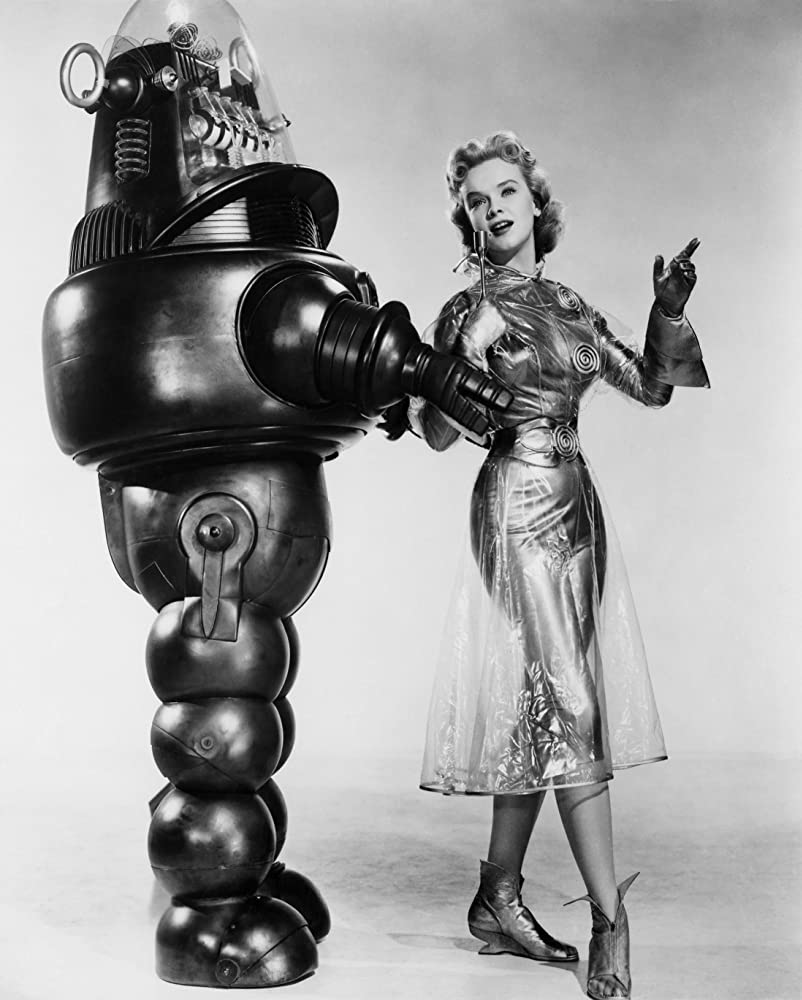 Anne Francis and Robby the Robot in Forbidden Planet (1956)