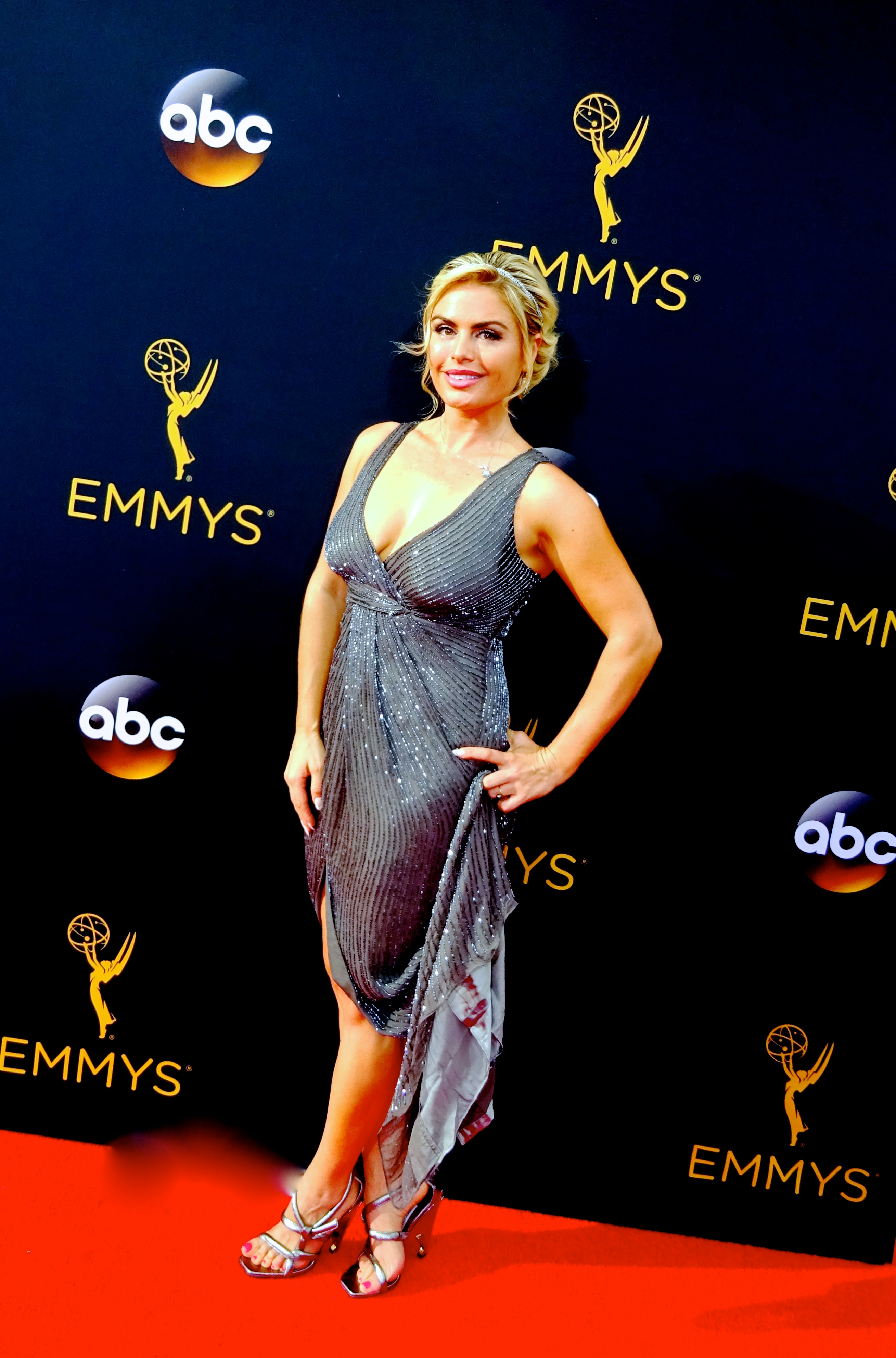 Tia Barr attends the 68th Emmy Awards~