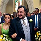 Ivan Kaye and Samantha Barks in The Revenger: An Unromantic Comedy (2019)