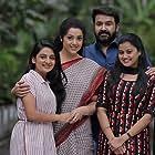Mohanlal, Meena, Esther Anil, and Ansiba in Drishyam 2 (2021)