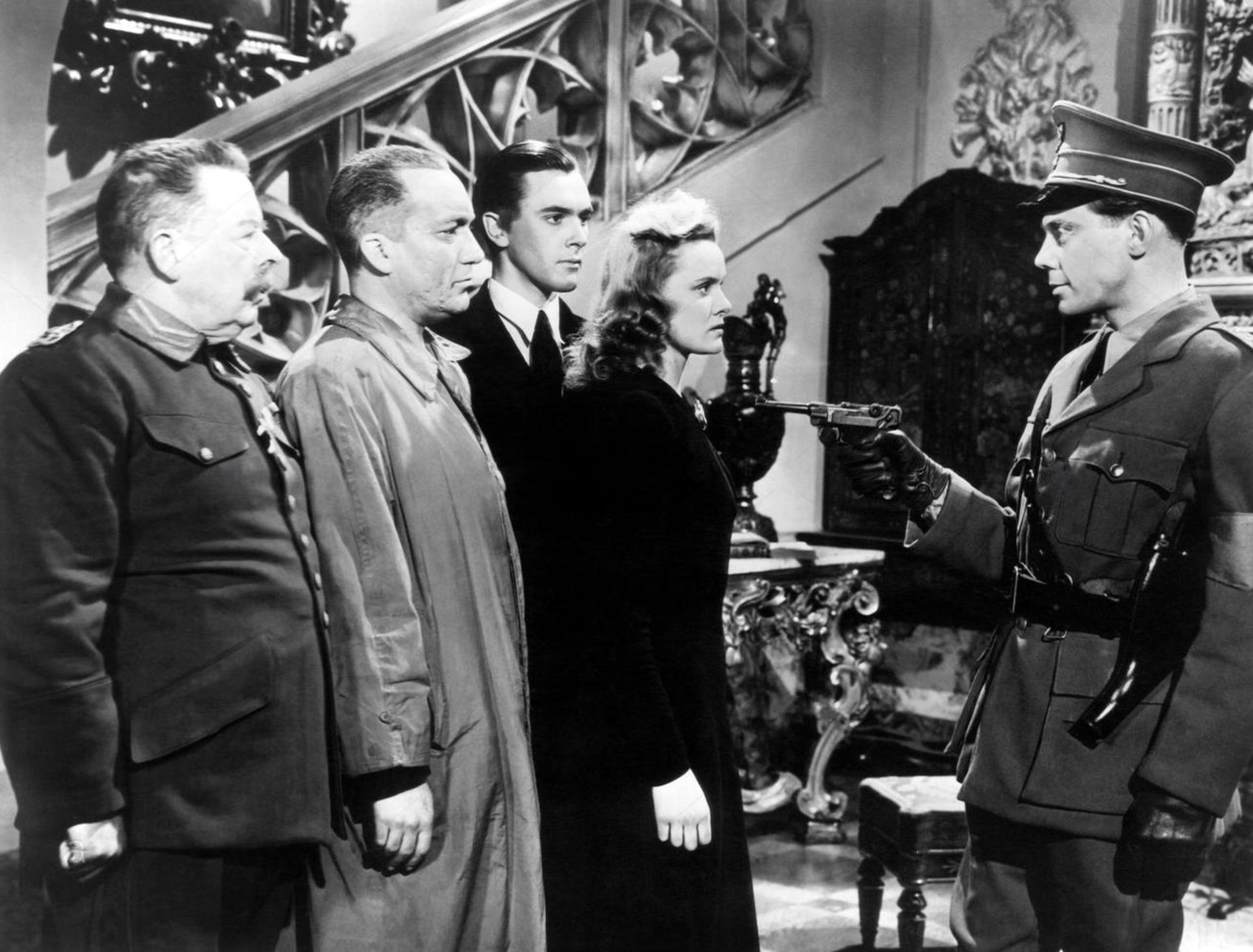 Proudly resisting. L-R, Seymour Hicks, Wilfrid Lawson, Brian Worth, Nova Pilbeam and Marius Goring in Pastor Hall (1940).