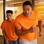 Dominic Goodman and Uli Latukefu in Young Rock (2021)