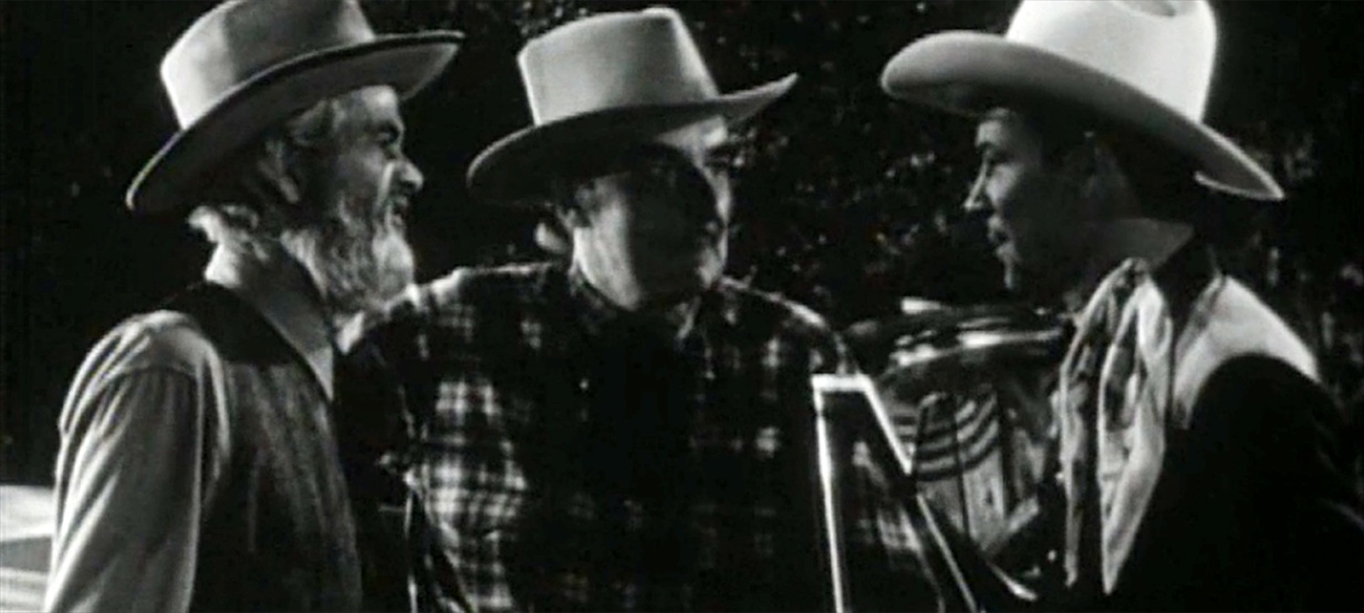 Roy Rogers, Douglass Dumbrille, and George 'Gabby' Hayes in Under Nevada Skies (1946)