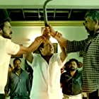 Brahmanandam, Upendra, and Sampath Raj in S/O Satyamurthy (2015)