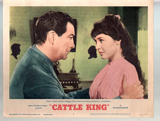 Robert Taylor and Maggie Pierce in Cattle King (1963)
