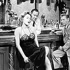 Gloria Grahame, Tol Avery, and Joseph Mell in Naked Alibi (1954)