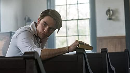 Some people are just born to be buried.   In Knockemstiff, Ohio and its neighboring backwoods, sinister characters, an unholy preacher (Robert Pattinson), twisted couple (Jason Clarke and Riley Keough), and crooked sheriff (Sebastian Stan), converge around young Arvin Russell (Tom Holland) as he fights the evil forces that threaten him and his family. Spanning the time between World War II and the Vietnam war, director Antonio Campos THE DEVIL ALL THE TIME renders a seductive and horrific landscape that pits the just against the corrupted. Co-starring Bill Skarsgård, Mia Wasikowska, Harry Melling, Haley Bennett, and Pokey LaFarge, this suspenseful, finely-woven tale is adapted from Donald Ray Pollock's award-winning novel.