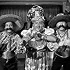 Moe Howard, Larry Fine, and Curly Howard in Time Out for Rhythm (1941)