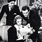Kenne Duncan, Warren Hull, and Iris Meredith in The Spider's Web (1938)