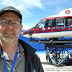 Doug Scroggins, Aviation Effects Supervisor on set for the film The Rescue and the  S-76 Helicopter Scroggins Aviation supplied for the film, is shown here on a gimbal.