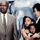 Ossie Davis, Kyla Pratt, Raven-Symoné, and Kristen Wilson in Doctor Dolittle (1998)
