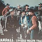 Hank Bell, Frank Ellis, Chick Hannan, and Jack Randall in Covered Wagon Trails (1940)