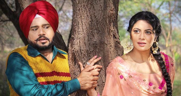 Kavita Kaushik and Karamjit Anmol in Mindo Taseeldarni (2019)