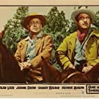 Alan Ladd and Gilbert Roland in Guns of the Timberland (1960)