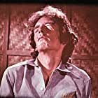 Roger Garrett in Night of the Cobra Woman (1972)