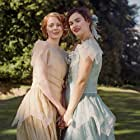 Emily Beecham and Lily James in The Pursuit of Love (2021)