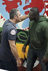 Taylor Kinney and Stefan Holdbrook in Chicago Fire (2012)