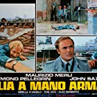 Maurizio Merli and John Saxon in Italia a mano armata (1976)