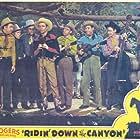 Roy Rogers, Pat Brady, Hugh Farr, Karl Farr, Bob Nolan, Lloyd Perryman, Sons of the Pioneers, and Tim Spencer in Ridin' Down the Canyon (1942)