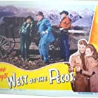Robert Mitchum, Barbara Hale, and Thurston Hall in West of the Pecos (1945)