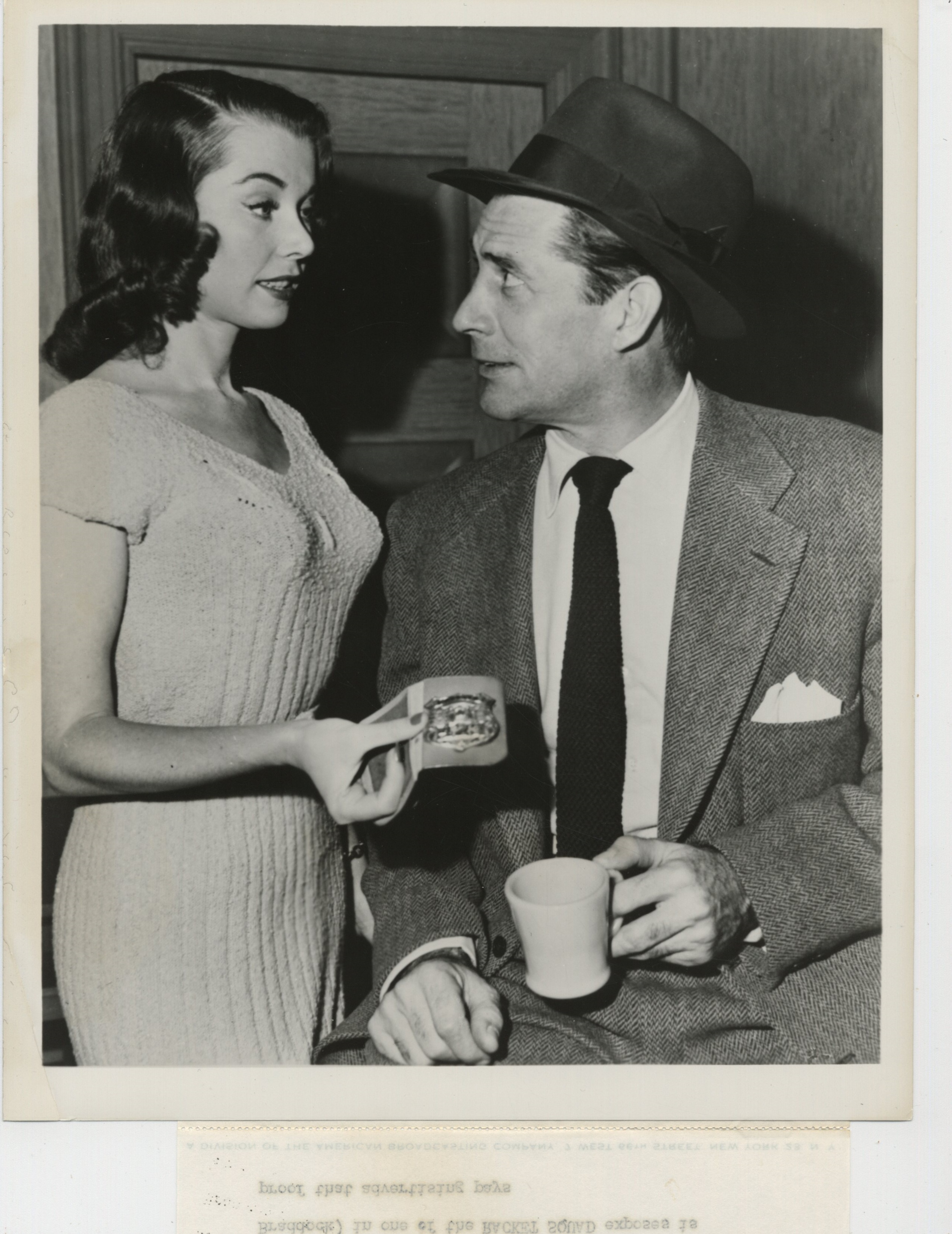 Reed Hadley and June Wurster in Racket Squad (1950)