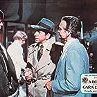 Richard Bakalyan, Gregg Palmer, and Robert Sacchi in The Man with Bogart's Face (1980)