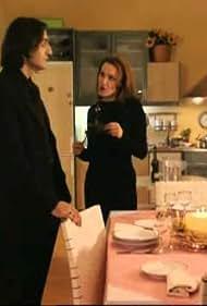 Renia Louizidou and Akis Sakellariou in Ouden provlima (2000)