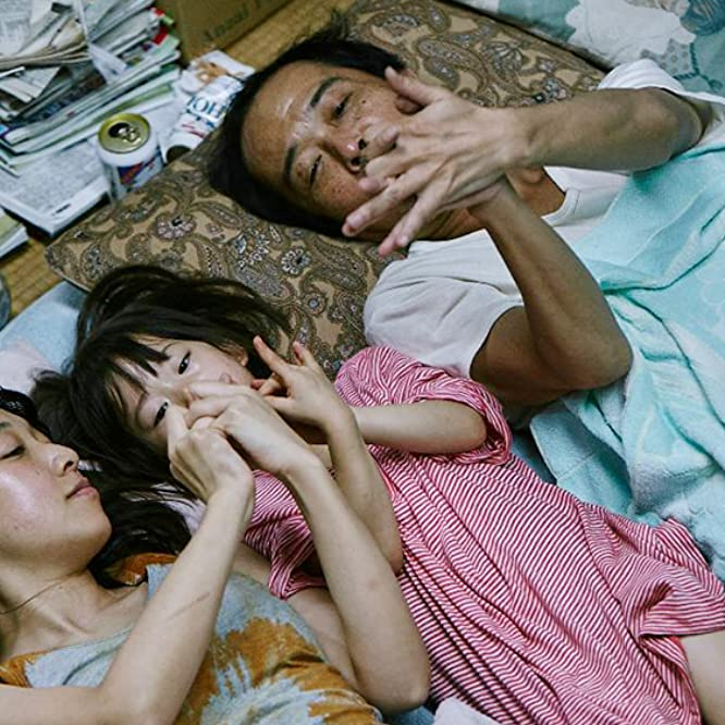 Lily Franky and Sakura Andô in Shoplifters (2018)