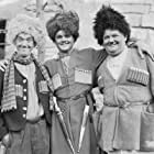 Oliver Hardy, Stan Laurel, and Lawrence Tibbett in The Rogue Song (1930)