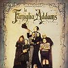 Christina Ricci, Raul Julia, Christopher Lloyd, Anjelica Huston, Judith Malina, Carel Struycken, and Jimmy Workman in The Addams Family (1991)