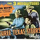 John Wayne, Ray Corrigan, and Max Terhune in Three Texas Steers (1939)