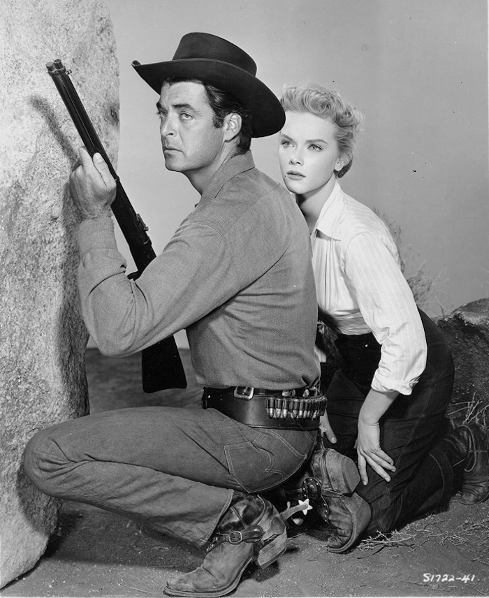 Rory Calhoun and Anne Francis in The Hired Gun (1957)