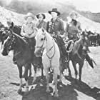 William Boyd, Russell Hayden, George 'Gabby' Hayes, and Billy King in Texas Trail (1937)