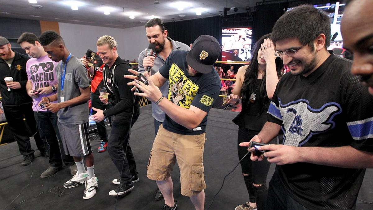 Nic Nemeth, Aron Stevens, and Austin Watson at an event for WWE 2K15 (2014)