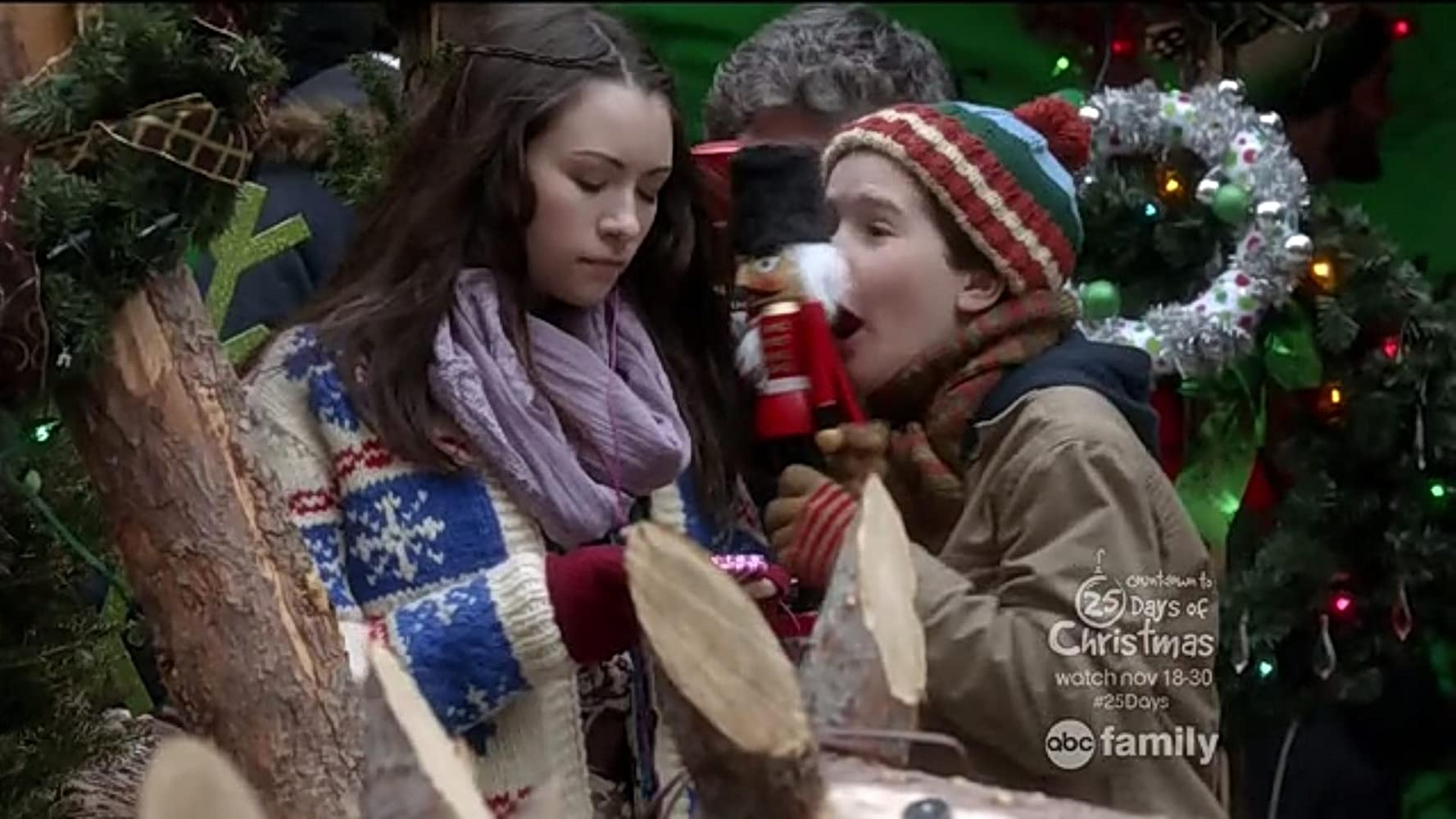 Jodelle Ferland and Christian Martyn in Home Alone: The Holiday Heist (2012)