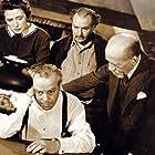 Egon Brecher, Helen Freeman, and Steven Geray in So Dark the Night (1946)