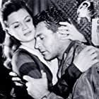 Angie Dickinson and Gene Barry in China Gate (1957)