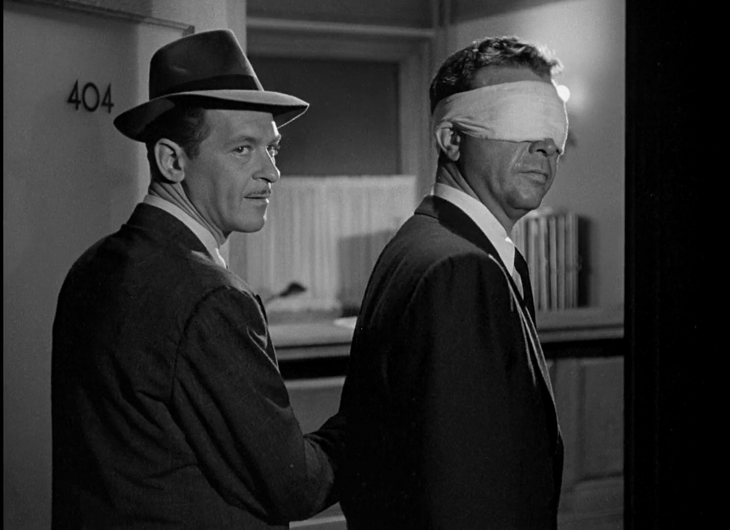 Paul Phillips and Dick Powell in Murder, My Sweet (1944)