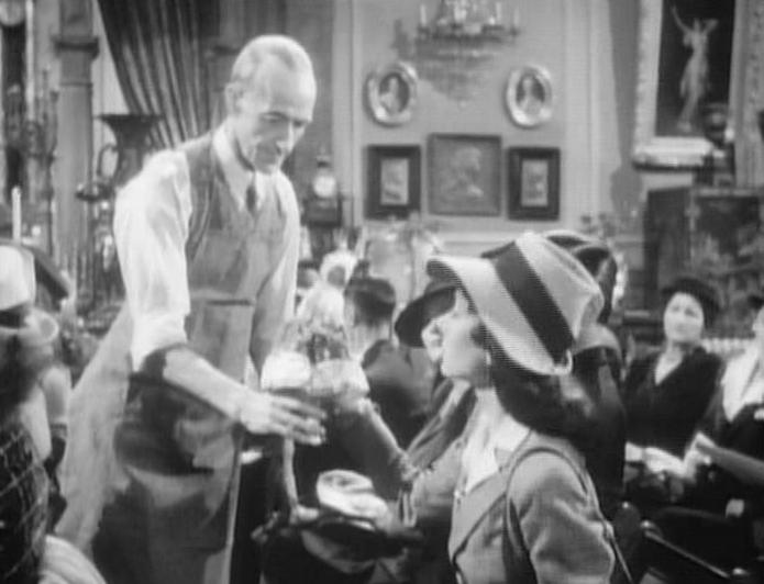Patricia Cameron, Bess Flowers, and Ian Wolfe in Dressed to Kill (1946)