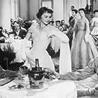 Olivia de Havilland, John Forsythe, and Tommy Noonan in The Ambassador's Daughter (1956)