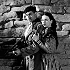 Alan Curtis and Patricia Morison in Hitler's Madman (1943)